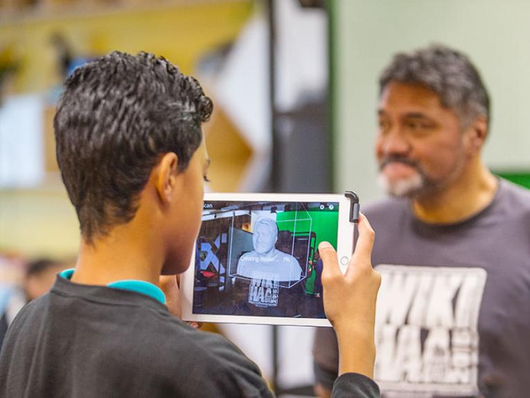 A student takes a 3D model of his teachers face
