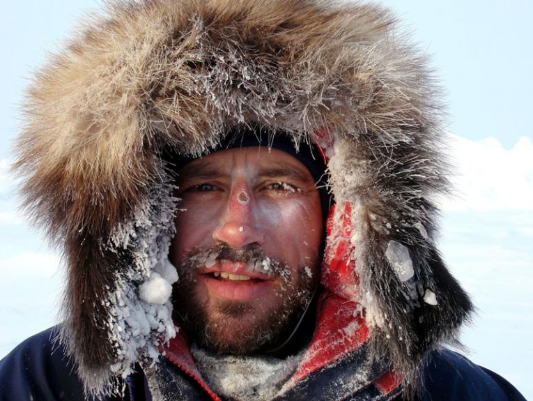 Explorer Adrian Hayes covered in snow