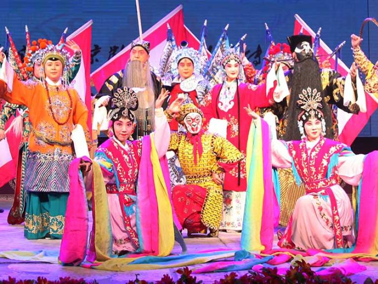 The opera performers on stage in costume