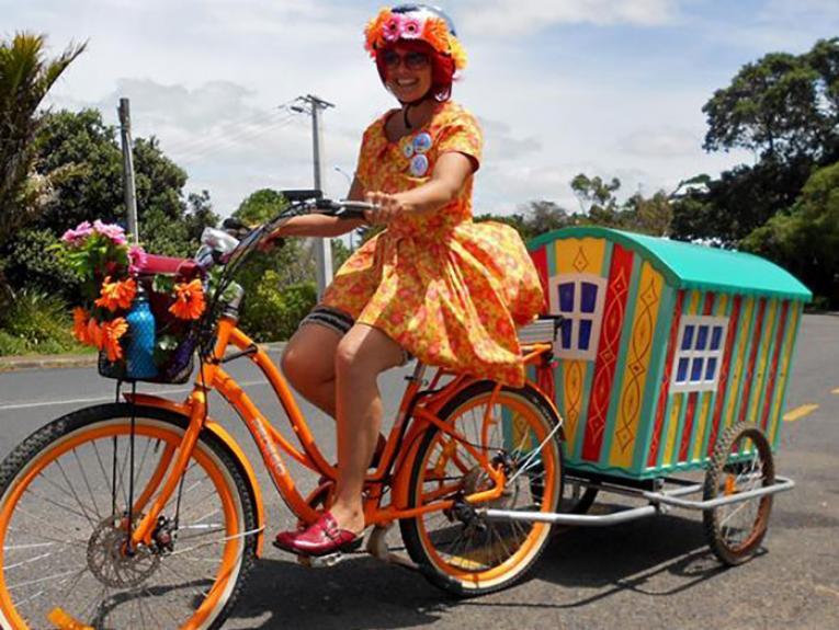 Tanya Batt as Belle on a bike