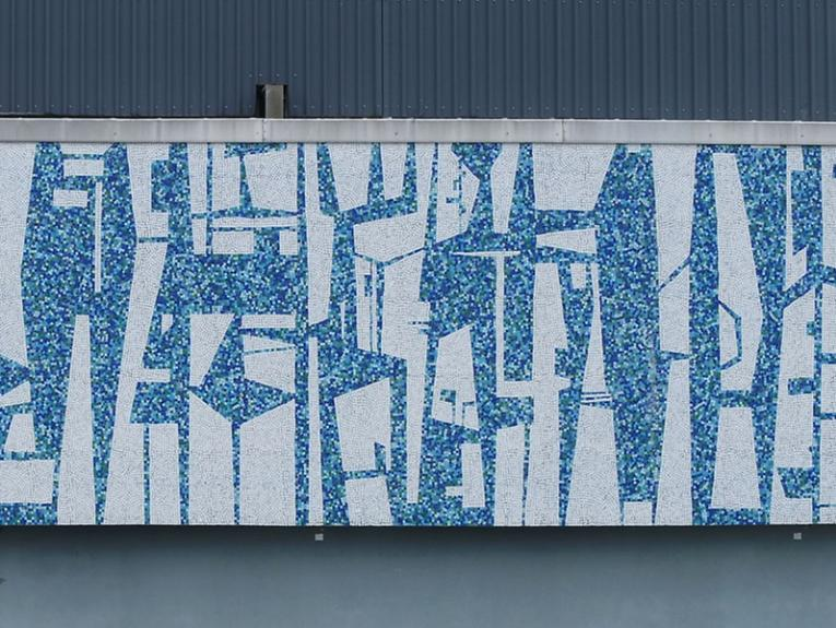 A blue and white mural on the outside wall of a building