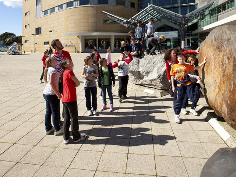 Children play on Te Papa's large exterior boulders