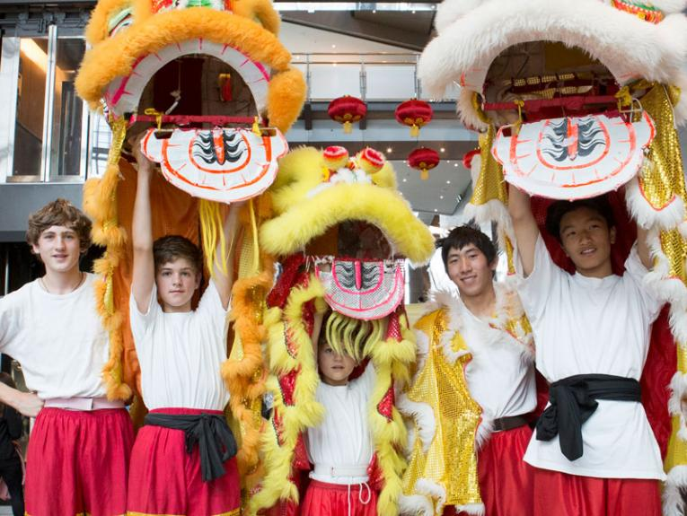 Children with Chinese dragon puppets