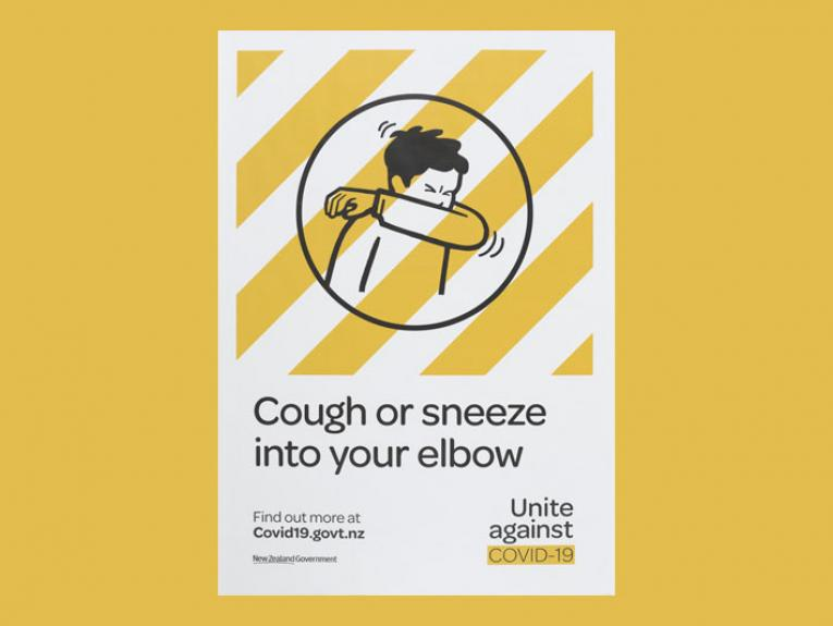 Poster featuring an illustration of a person sneezing into their elbow underneath a layer of yellow stripes and the text underneath saying 'Cough or sneeze into your elbow'