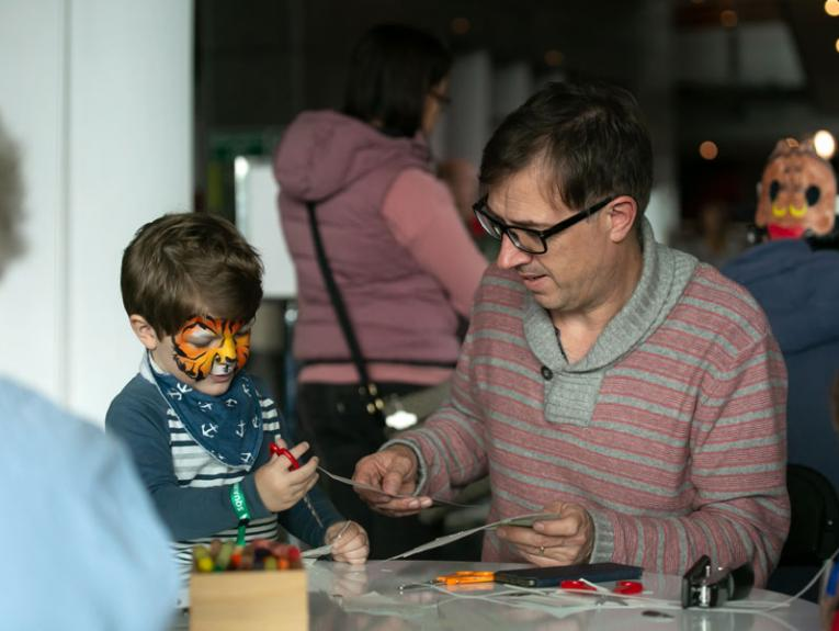 Father and son doing craft together