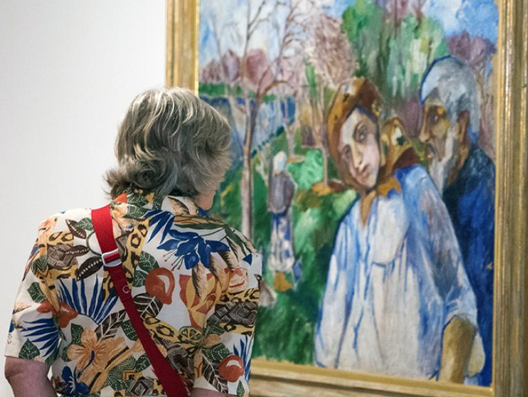 Lady looking at an art work