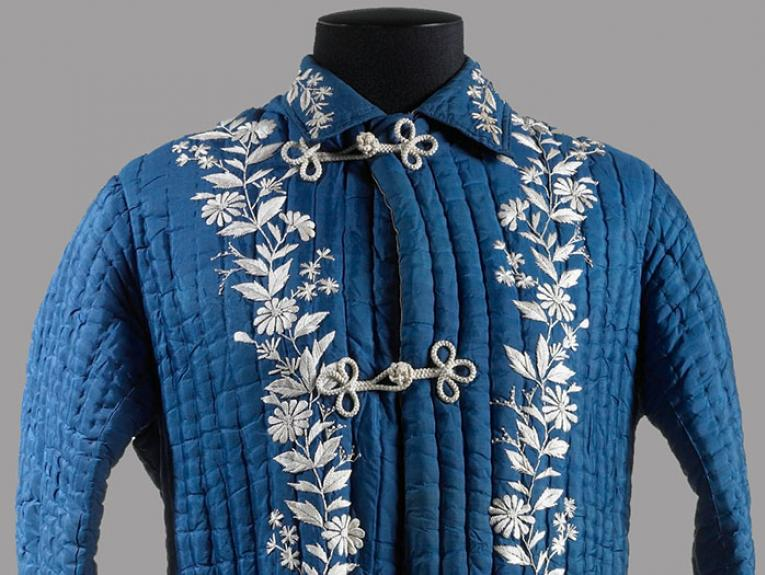 Woman's blue dressing gown with embroidered silver flowers