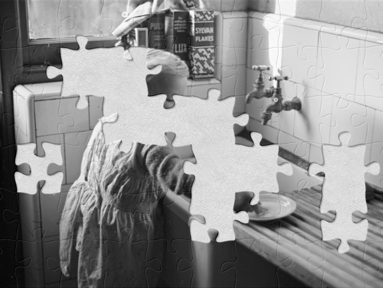 A black and white photo with jigsaw pieces missing