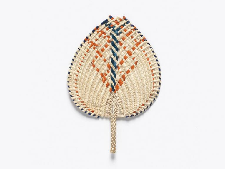 Fan made of coconut and pandanus leaves, featuring an orange and blue pattern woven throughout