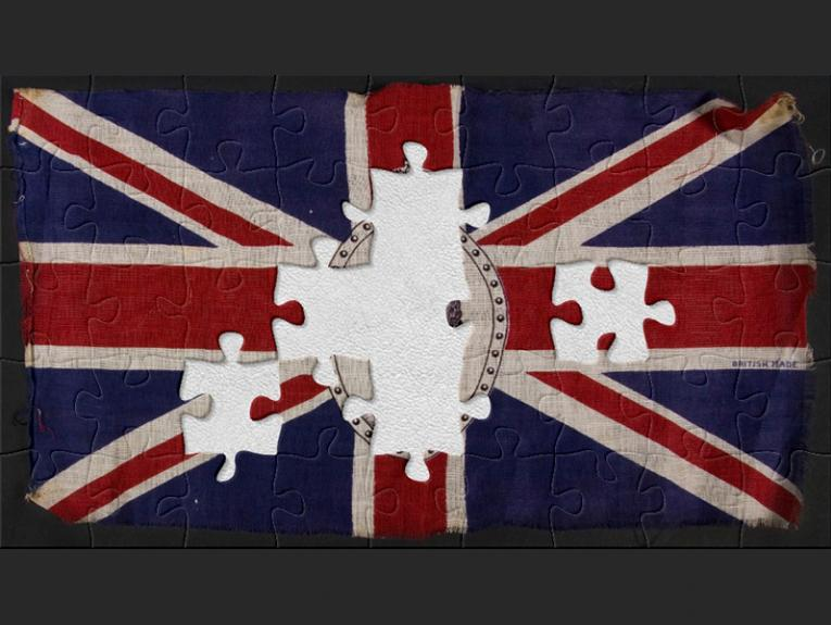 Red, blue and white Union Jack linen flag with a black and white image of Queen Elizabeth in the centre.