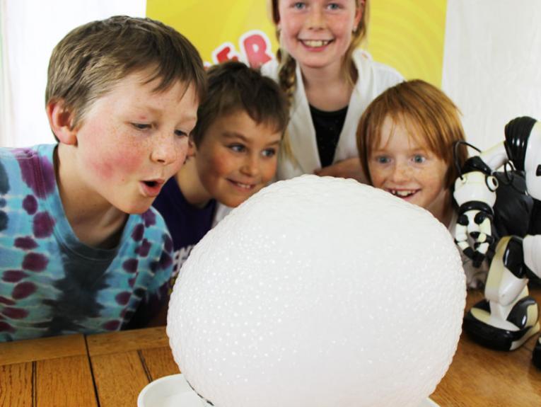 Kids look at foam