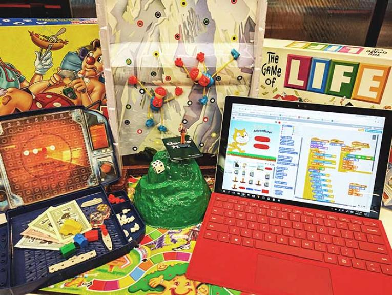 A selection of old and new games including 'Battleship' and a laptop