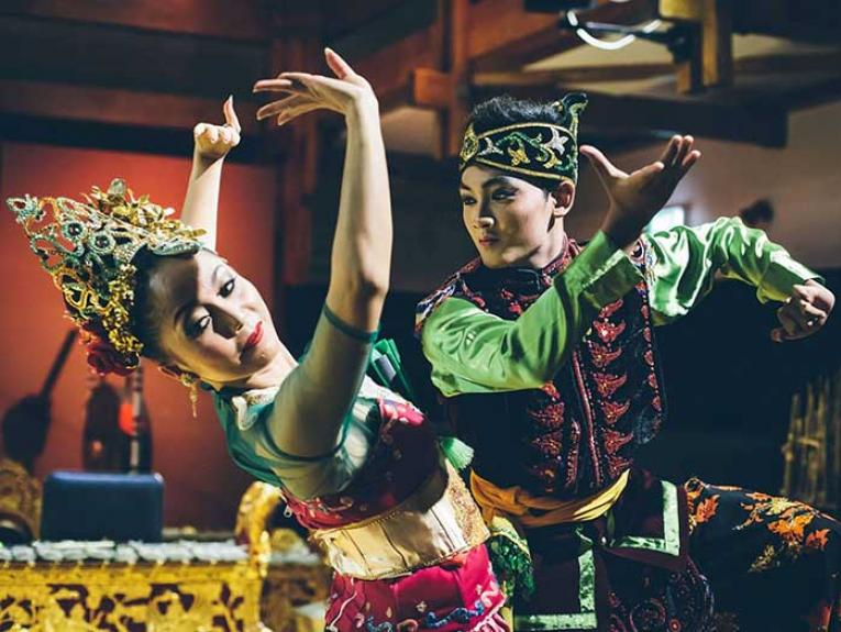 A man and a woman perform an Indonesian Dance