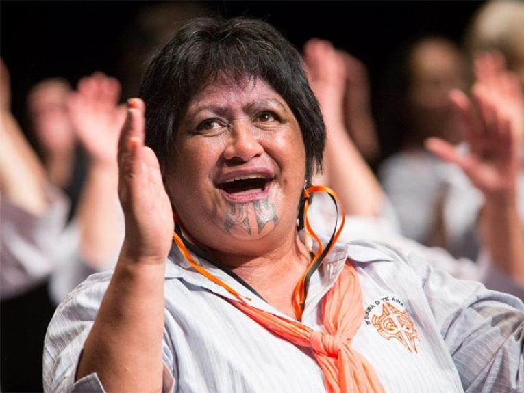 A lady sings during a kapa haka performance