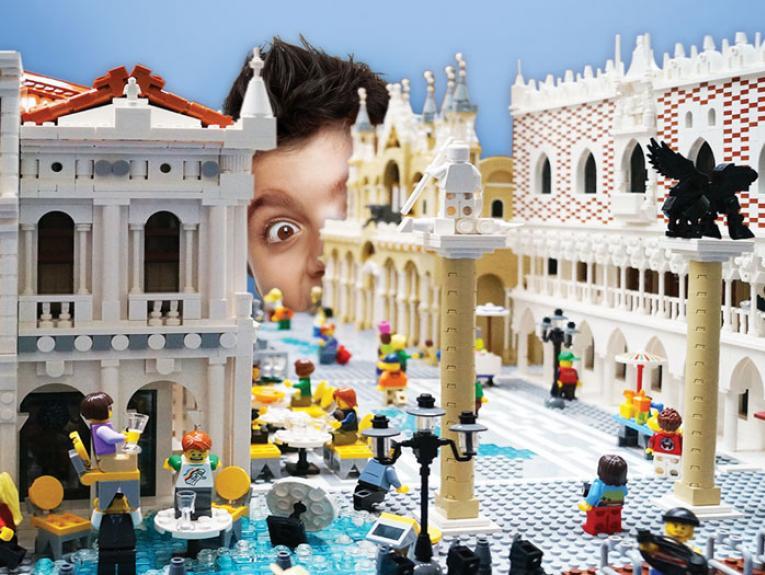 Boy looks at LEGO sculpture