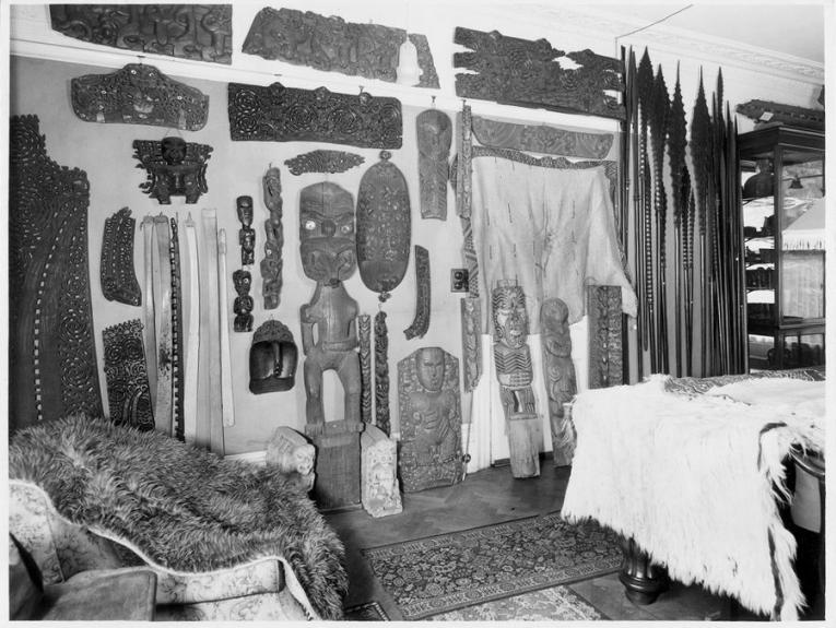 Black and white photo of Pacific carvings and collection items