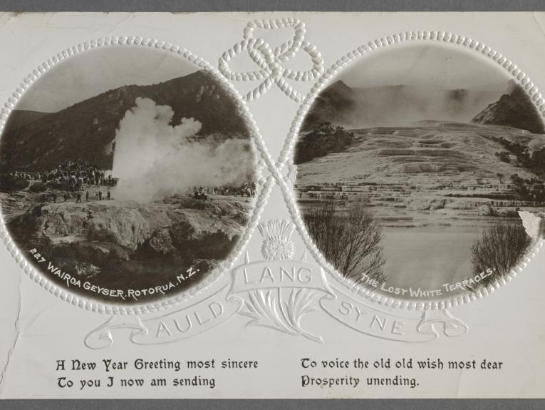 Two round images on a card. One with a geyser and one with the pink and white terraces.