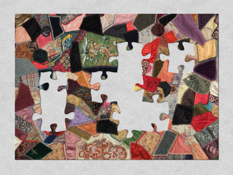 1920s crazy patchwork quilt created using a wide variety of textiles which reflect the diversity of textiles used in fashion at this time
