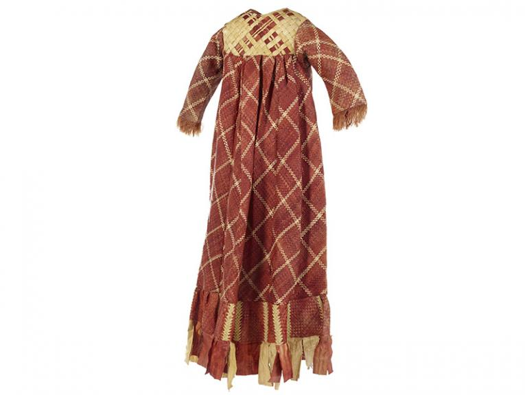 A red and yellow long dress woven with pandanus leaves