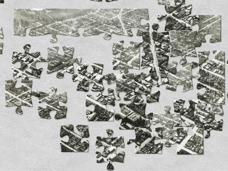 Digital photo that has been cut up, digitally, into jigsaw pieces, and scattered