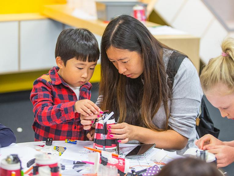Children building robots that make their own art.