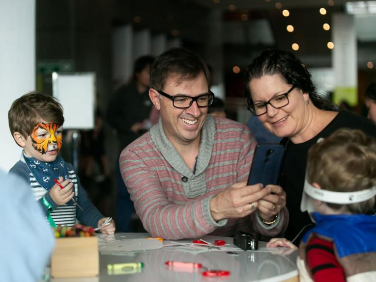 A family making bird masks together
