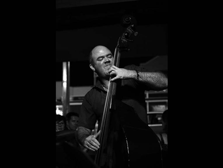 Black and white image of a man playing the double bass
