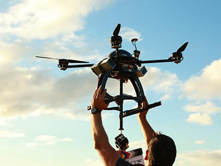A man flies a drone