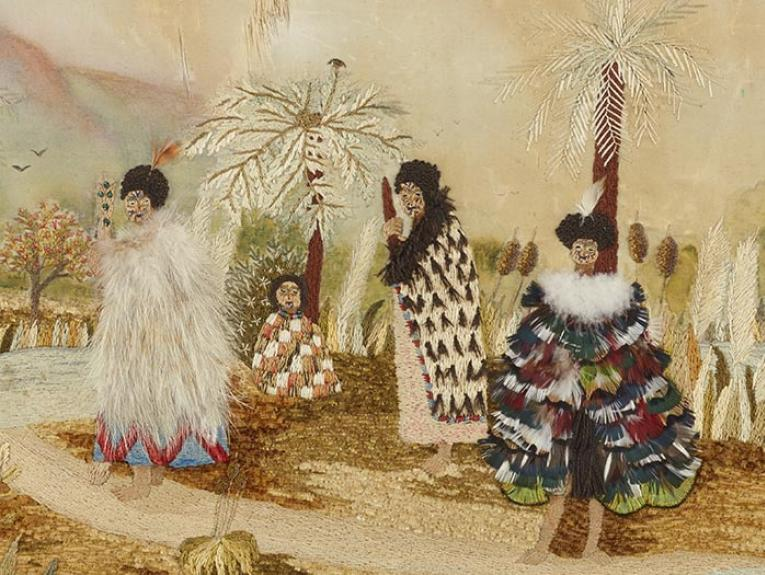 An embroidered scene of a Maori village