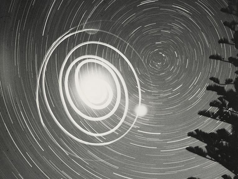 Black and white long-exposure photograph of a star trail