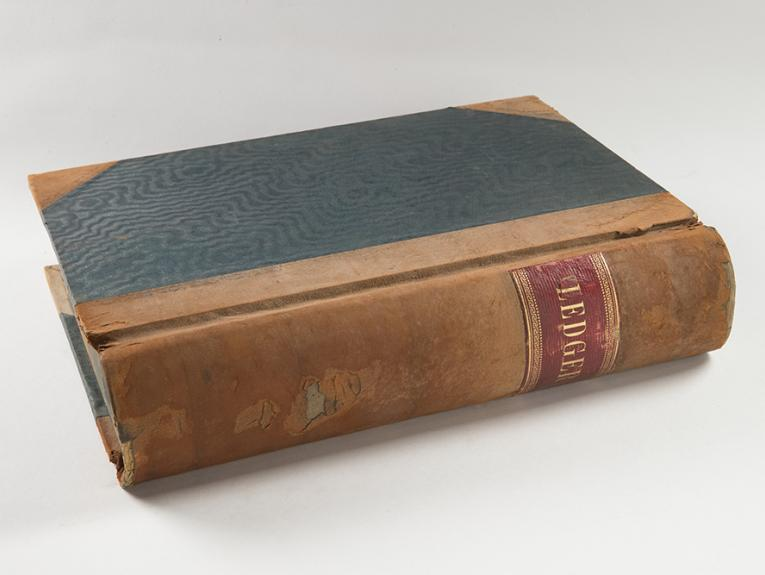 An old leather-bound book with a green cover