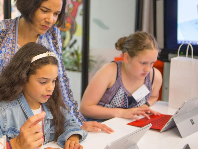 Girls with their mums coding