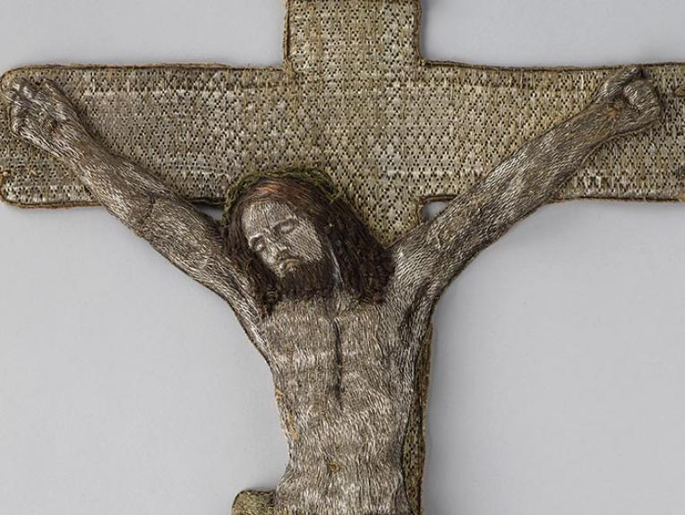 Gilded silver, copper wire and silk thread woven in the shape of a cross with Christ on it
