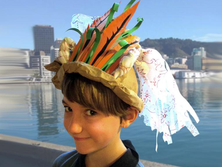 Child wearing hand-made paper hat