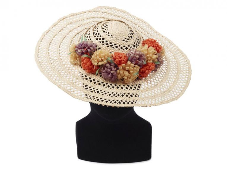 large brimmed woven sun hat with floral decoration