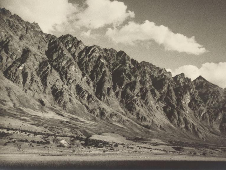 Black and white photo of craggy mountain tops