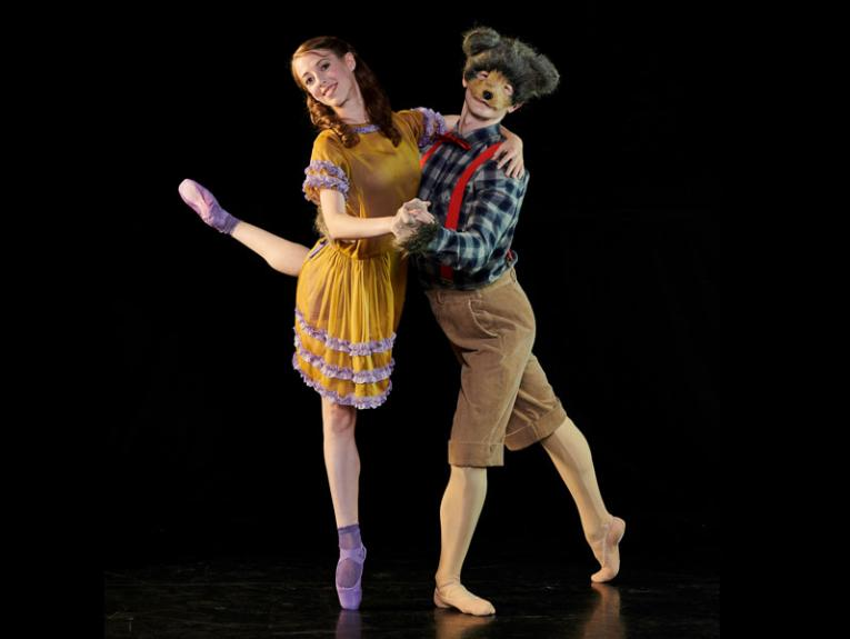 Two ballet dancers, one dresses as a bear, the other in a yellow dress