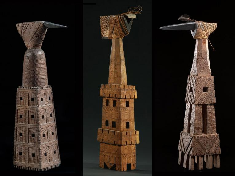 three wooden tools that look like towers