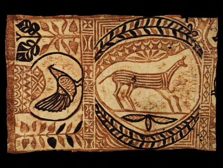 Material made from bark with animals designs painting on it in brown natural colours