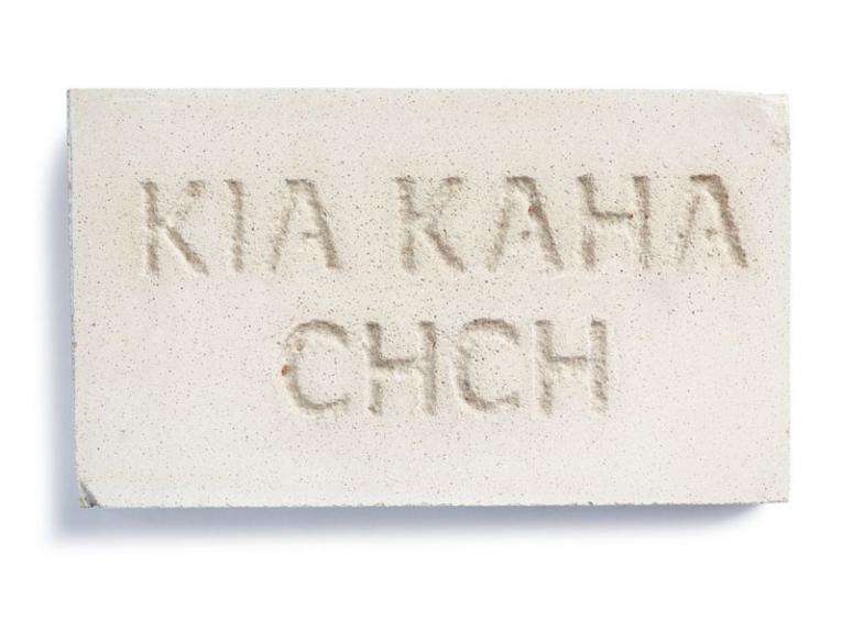 A brick with the words Kia Kaha Chch engraved on it