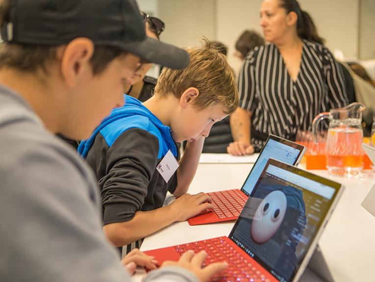 Kids using technology to create virtual sculptures.