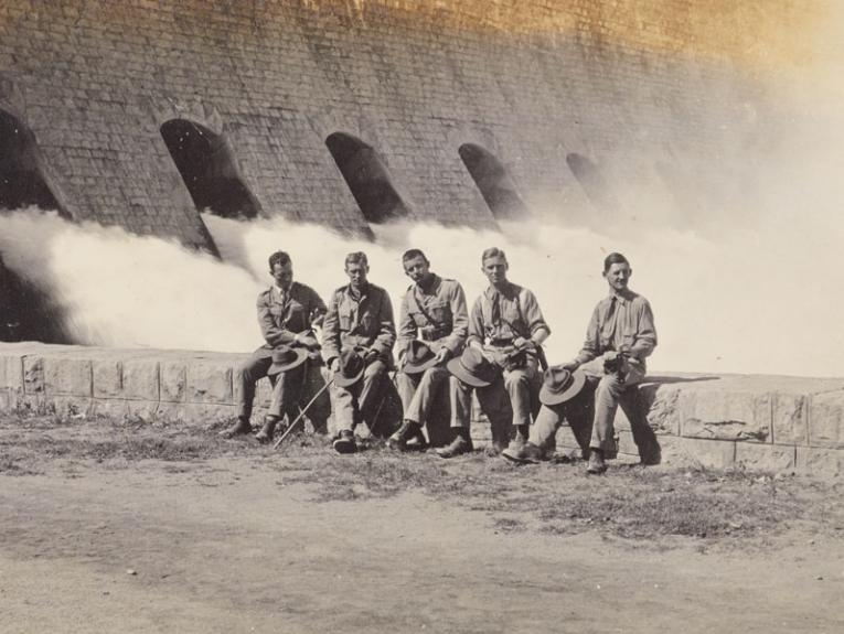 Soldiers pose for a photo by the Assuan Dam on the Nile