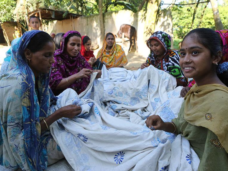 Stitching a kantha near Bogra