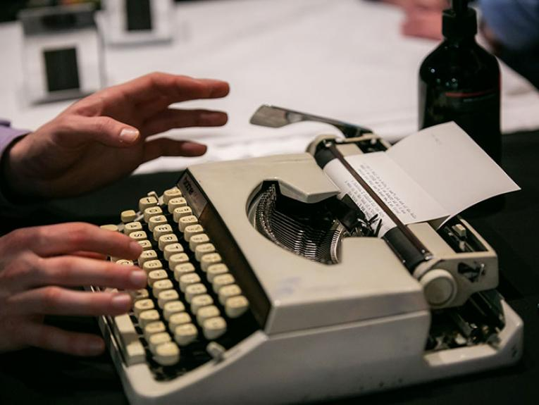 Close-up of a person using a typewriter