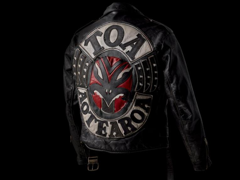 A black leather gang jacket with the word 'Toa Aotearoa' on it