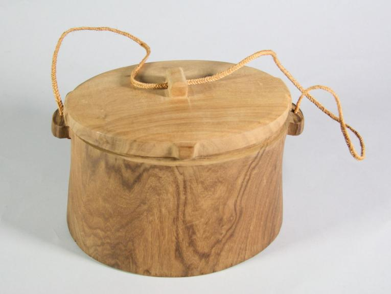 Small wooden box with a string handle