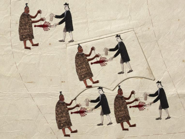 Embroidered image of a Māori man exchanging a crayfish with a white man