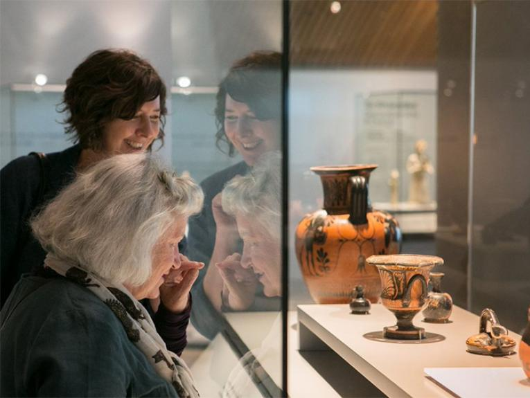 Visitors in the exhibition Inspired: Ceramics and jewellery shaped by the past