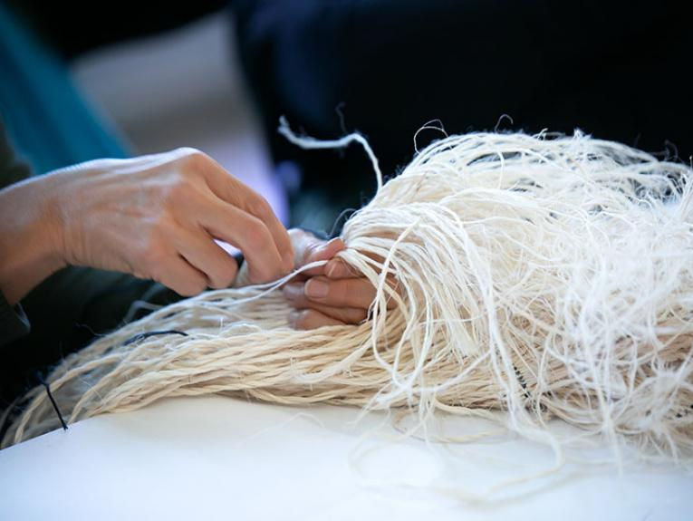 Close up of a person weaving
