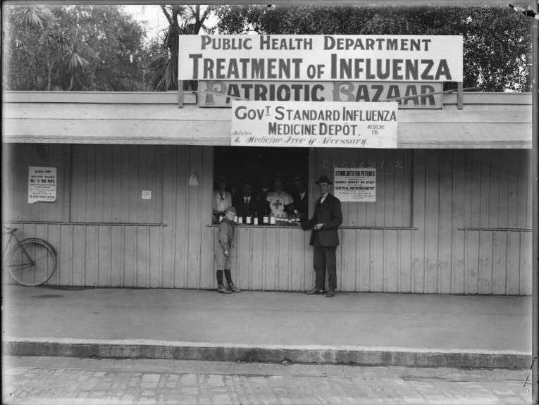 An influenza medicine depot a man and a boy stand outside